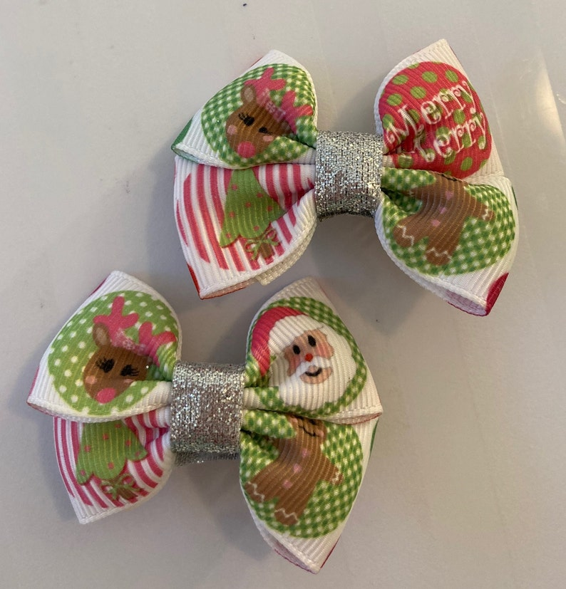 Beautiful Santa and Rudolph Christmas inspired hair bows for girls Look really cute over pig tails.