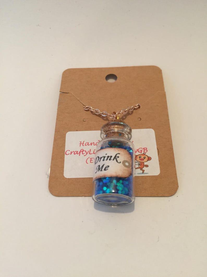 Drink me inspired necklace Tea party alice wonderland inspired necklace item 388 by CraftyLittleMonkeyGB Drink me potion necklace