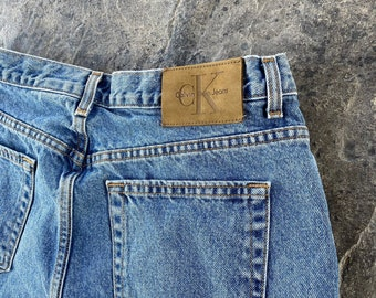 90s Calvin Klein High Waisted Tapered Leg Medium Wash Jeans Blue Vintage 33 X 32 14