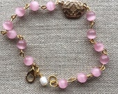 pink cats eye beaded bracelet cancer awarness bracelet delicate gold light pink feminine bracelet handcrafted