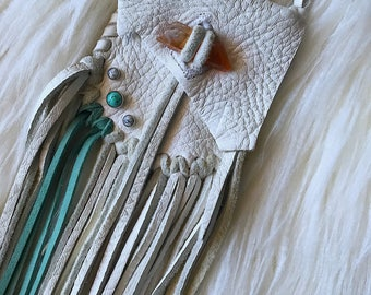 White leather medicine pouch