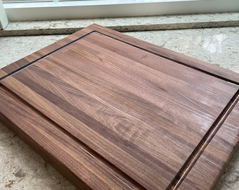 Solid, extra large Walnut cutting board with juice groove. For the chef, kitchen, craftsman, elegant styling, rich wood grain.