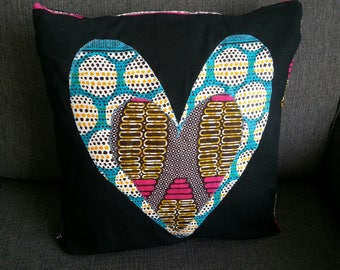 Heart made of wax on pillow cover