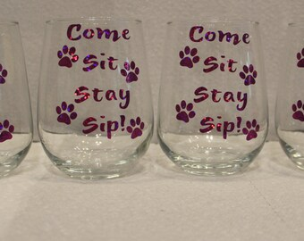 Set of 4 stemless 17 oz wine glasses decorated with exterior grade vinyl appliques.