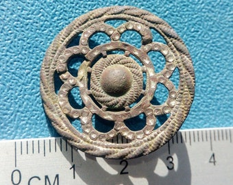Vintage brass button of the 19th century