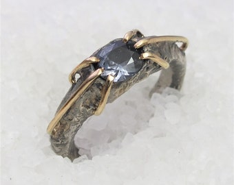 Engagement ring, gray color spinel, gold, silver.