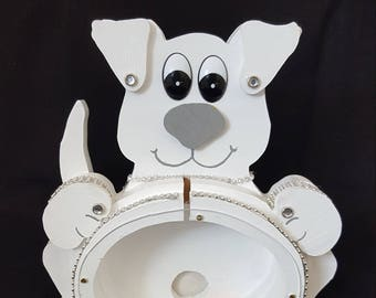 Dog Bank dressed in white with lots of bling