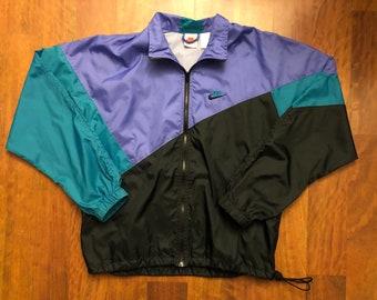 7937e67ea3f5 Vintage 90s Nike Full Zip Zip Lightweight Windbreaker Jacket Men s Small