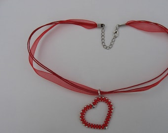 Woven red and silver beaded heart pendant