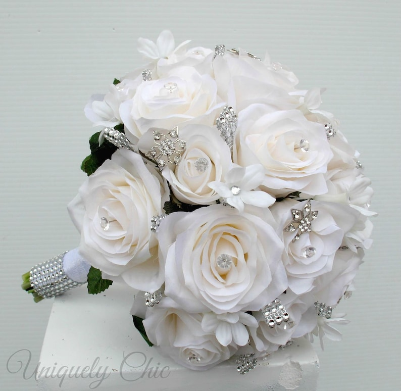 White rose rhinestone bride Crystal gem bridal blooms for winter wedding. Bling wedding bouquet maid of honor ceremony flowers