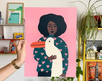 A girl with a big pelican bird on a pink background 30 x 40 poster print