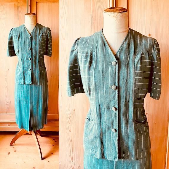 1940s puffed sleeve green linen sportswear suit.