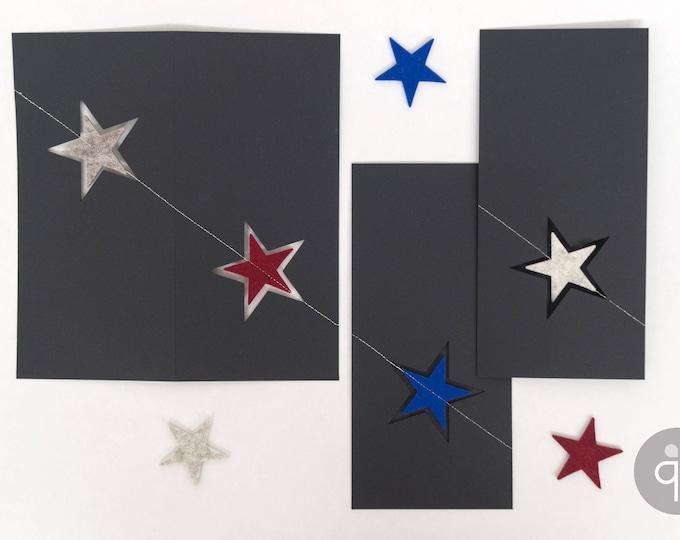 quadu Christmas card - two stars - black