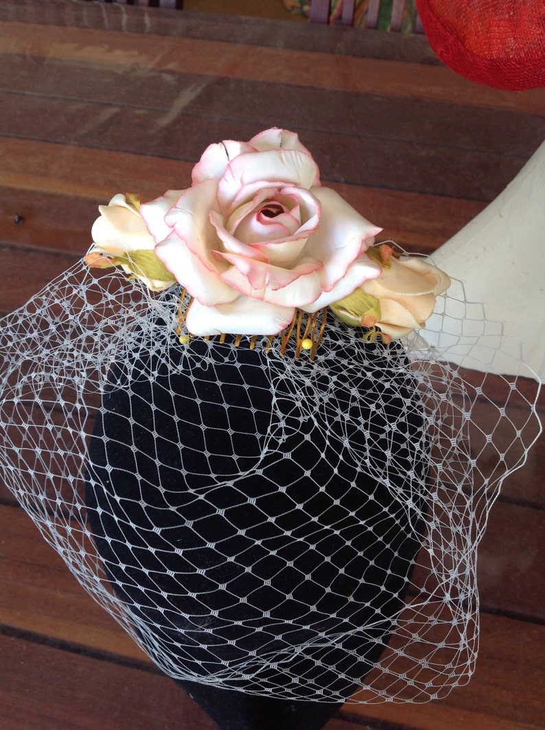 Bridal headpiece three roses on a comb  with birdcage veil