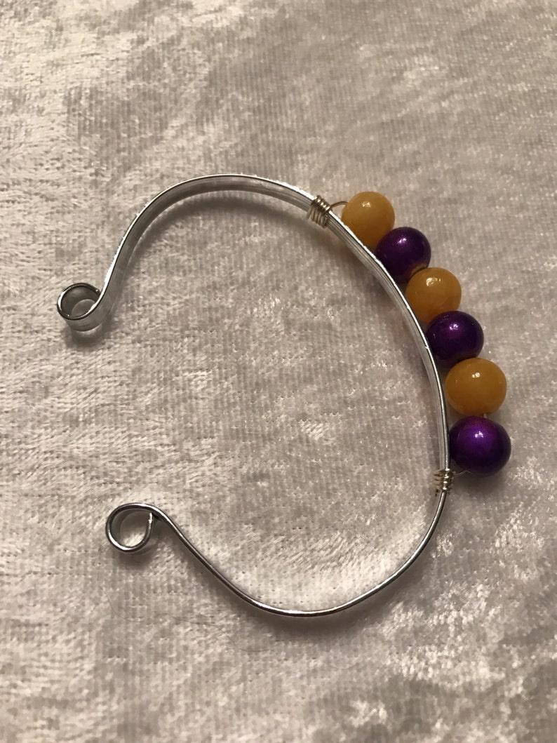 Purple /& Yellow cuff bracelet.