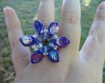 ring beads blue flower