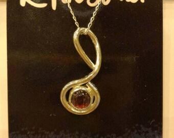 Silver curled garnet pendant