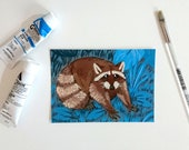 Raccoon in a vegetal background, postcard A6-format