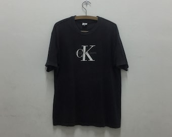 Vtg CALVIN KLEIN JEANS Big Logo SpellOut Black T-Shirt Sz S/M Made in Usa