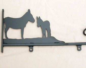 Hanging sign with Donkeys motif