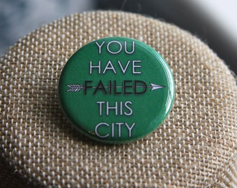 Arrow You Have Failed This City Button