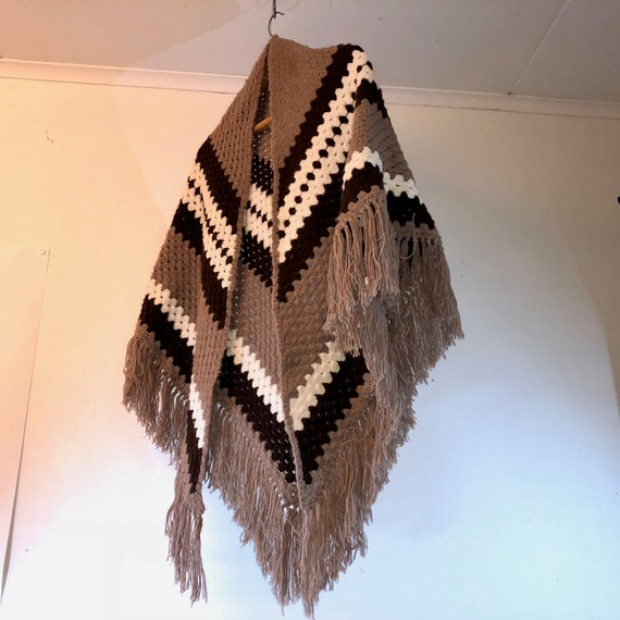 Retro knitted poncho from 1970s