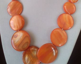 Orange shell necklace, bracelet, and earrings