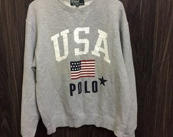 def1ea08d663b Vintage 90s POLO Ralph Lauren USA Flag Logo Crewneck Sweatshirt