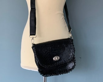 Vintage style shoulder bag belt bag made of black leather.