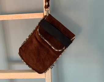 Brown suede leather phone case with a snake print edge