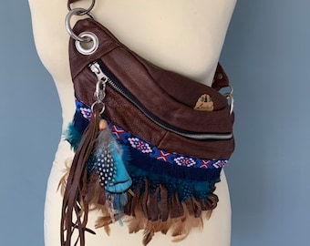 Boho Fanny pack of brown leather decorated with fringes and feathers