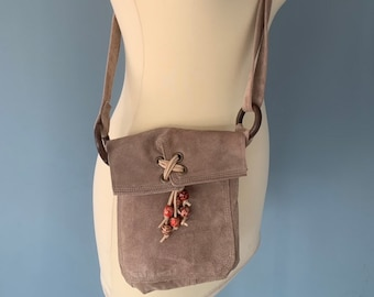 Small Shoudertasje leather pouch bag boho style