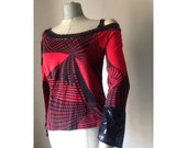 Red- black 90s top featuring abstract geometric pattern, cold shoulder, sequined neckline and cuffs.