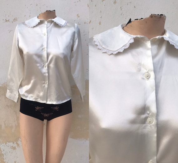 Satiny white 80's buttoned blouse features laced P