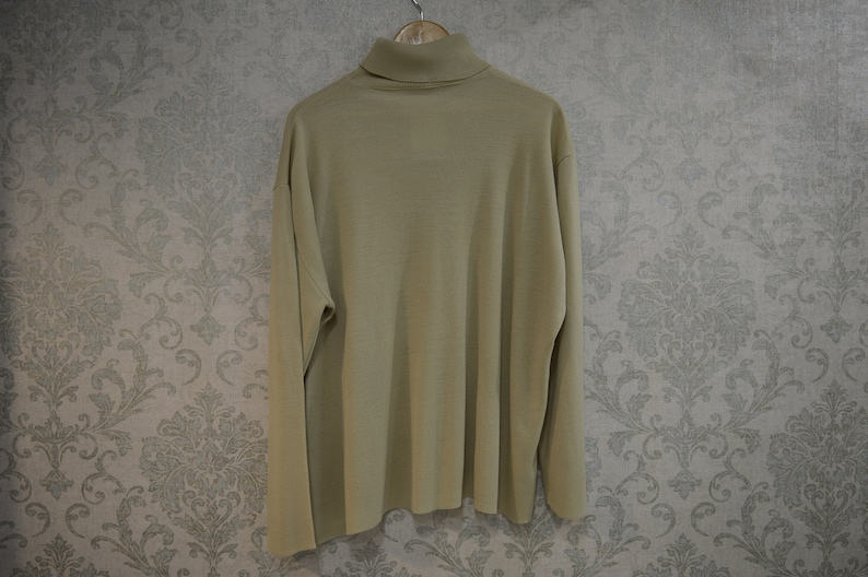 Vintage beige high-neck sweater with lace and ribbing accents