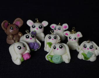 Handmade cold porcelain clay bunnies with roses charms