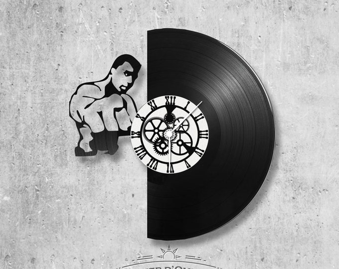 Vinyl record clock 33 rounds Mohamed Ali theme