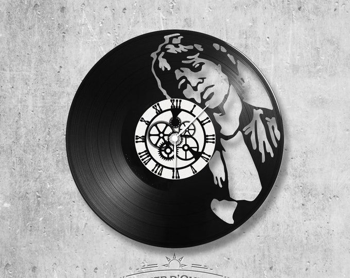 Vinyl record clock 33 rounds Mick Jagger theme