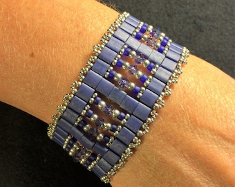 NO 64 Hand woven crystal and glass bracelet