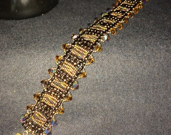 NO 55 Hand woven crystal and glass bracelet