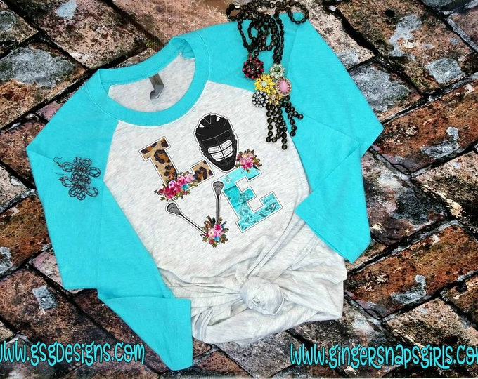 Featured listing image: Love Lacrosse Funky Lax Helmet and Poles leopard and flowers Unisex Fine Jersey 3/4 sleeve raglan t-shirt