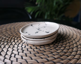 Small white stoneware clay plate, Black spot staining with a brush, Appetizer plate