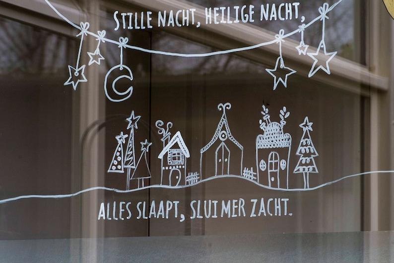 Stille nacht kerstliedje op raam raamtekening kerst image 0