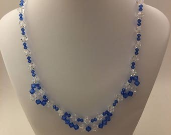 Gorgeous royal blue and clear Swarovski Crystal necklace and earring set.