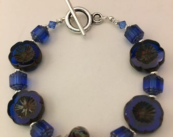 Royal blue hibiscus flower and cathedral bead bracelet set with lampwork bead and toggle clasp.