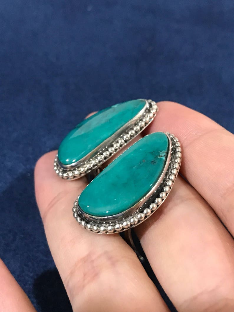500347 sterling silver handmade earrings Vintage solid 925 silver with oval shaped turquoise inlay with beads around details stamped 925