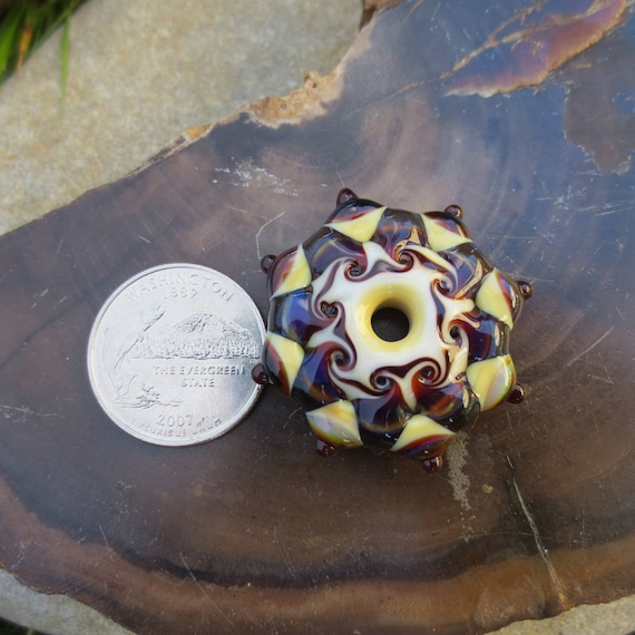 Lampwork vessel by glass artist Leah Nietz using a variety of soft glass then annealed for added strength Destash V-17