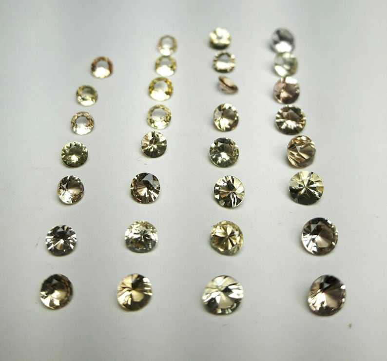 2.5-4mm round natural Imperial Topaz image 0
