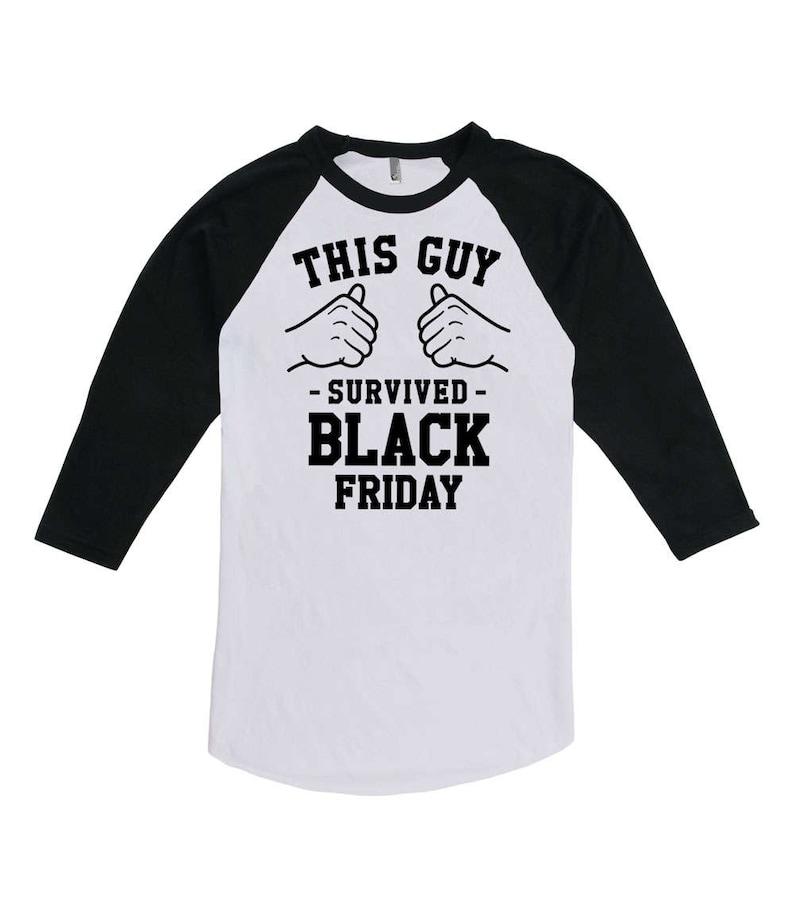 e02687350cd62 Funny Holiday Raglan This Guy Survived Black Friday Shirts | Etsy