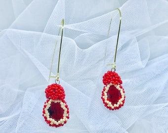 Blue earrings, Pierre Swarovski. Working Manual made with beads by hand.